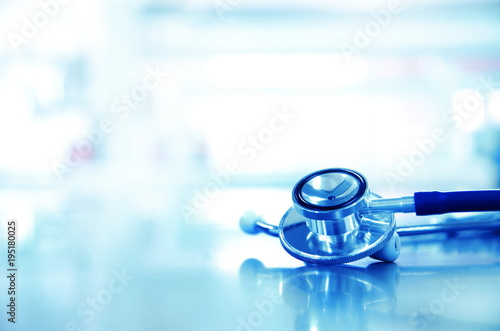 Fotografie, Obraz  metal stethoscope for doctor diagnosis in blue science laboratory background