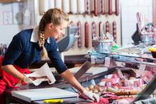 Sales Woman In Butcher Shop Pu...
