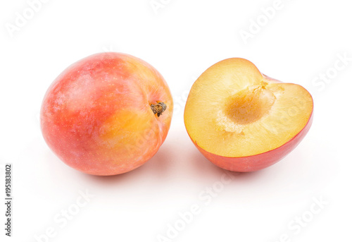 Photo Plum red orange and one half isolated on white background fresh and glossy