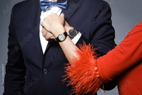 Well dressed stylish couple wearing wristwatches