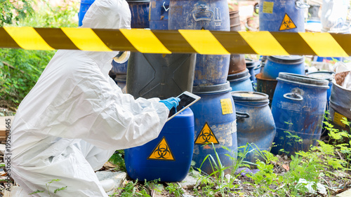Fotografie, Obraz  Asian scientist wear Chemical protection suit check danger chemical,working at d