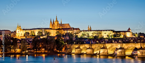 Leinwand Poster Panorama of Prague castle and Charles bridge by night, Czech republic