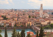 Verona, Italy. Aerial view with Adige River and Ponte di Pietra at summer day with blue sky. Panorama. Ancient european Italian city.