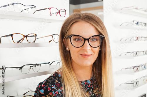Woman choosing eyeglass frame Wallpaper Mural