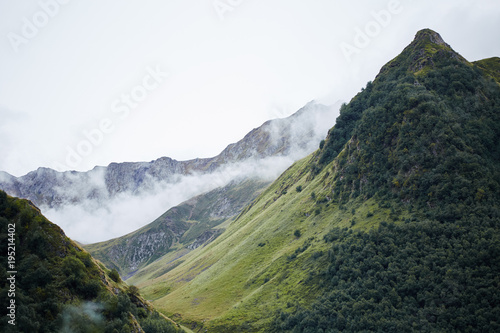 Amazing landscape view of misty Nordic mountains under overcast
