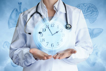 Doctor Shows The Clock On The Background Of Internal Organs .