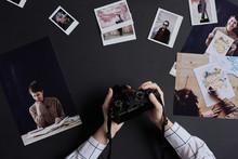 Photographer With Printed Pictures