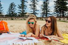 Women Listen To Music On Beach