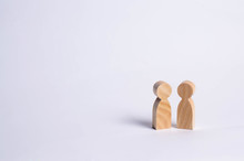 Wooden Human Figures Stand Tog...