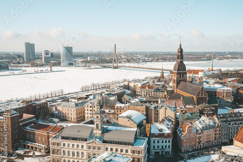 Poster Berlin Aerial winter view of the Riga old town from above with a view of river, national library and Dome Cathedral.