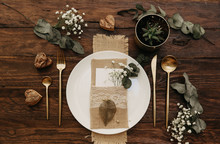 Rustic Wedding Table Set. Vintage Dining Table With Decorations, Flowers. Boho Style. Table Set For An Event, Party, Date Or Wedding.