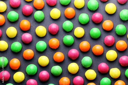 Foto op Aluminium Snoepjes Colorful sweet candies on a grey