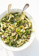 Sorgo bianco salad with chopped raw and cooked chicory, green asparagus, kale, fennel, fresh peas and artichokes seasoned with rocket pesto al pecorino.