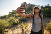 Fit Female African American Hiker Taking A Selfie On Smartphone While Out On Hike