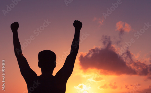 Winning and motivation. Young man feeling strong, victorious! Canvas Print