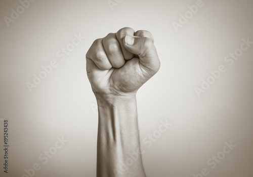Fotografiet Closeup of fist clenched in the air