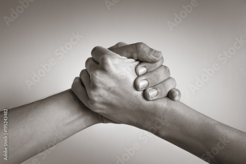 Hands coming together, helping hand  People working together, unity