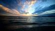 Colorfu sky over Alghero sea at sunset. Sardinia, Italy