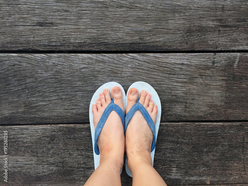 Selfie Blue Shoes Isolated on Wood Floor for Top View. Woman Wearing Blue Flip Flop (Sandal) on The Wooden Floor Background Great For Any Use.