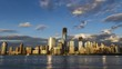 Manhattan skyline with Freedom Tower - timelapse from day to night with water in New York City NYC in 4K and 1080 HD