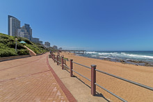 Promenade Beach Rocks Ocean Waves Blue Coastal City Skyline