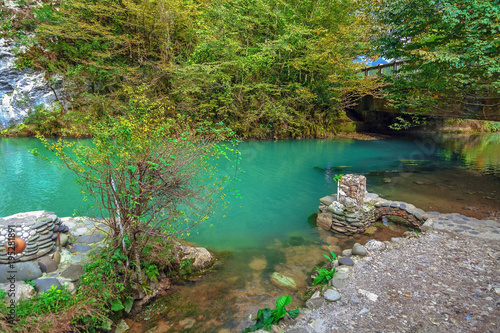 Blue lake in the autumn. Abkhazia, near the lake Ritsa. Canvas Print