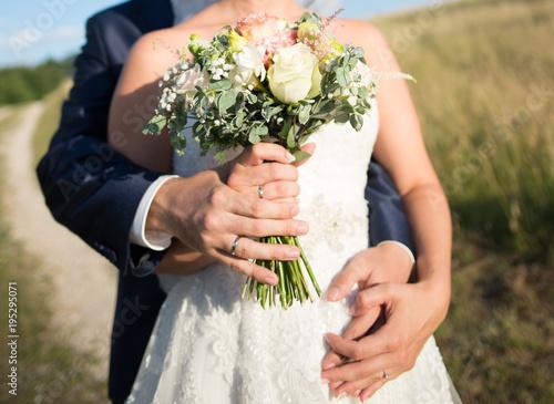 Fotografie, Obraz  Wedding bouquet in hand - outdoor summer wedding