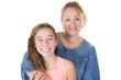 Happy mother and daughter having fun on white background