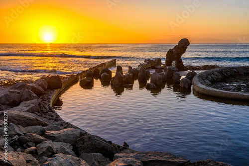 Sunset ocean landscape, Playa de la Americas on Tenerife, Canary Islands, Spain
