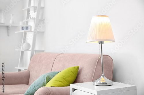 Room interior with elegant table lamp and comfortable sofa Canvas Print