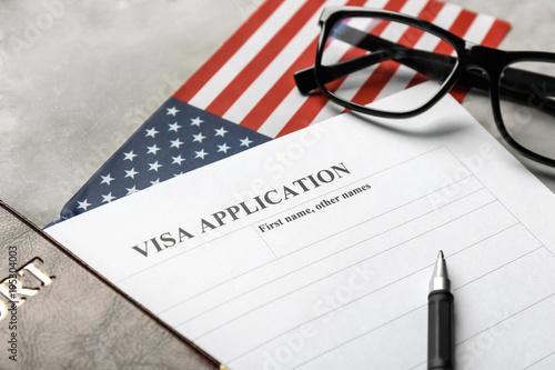 Fotografie, Obraz  Passport, American flag and visa application form on table