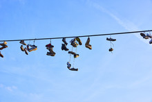 Old Shoes Hanging On Electrica...