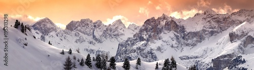 Beautiful Panorama of Marmolada group as seen from the Pass Pordoi in winter on the Italian Dolomites. Canazei, Italy.