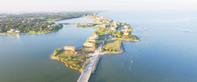 Panorama Aerial View Of Seabrook City Near Texas Gulf Coast And Clear Lake. Waterfront Harbor Town With Pier. Wooden Vacation House Under Construction. Real Estate And Beach Travel Background