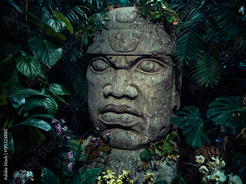 Door stickers Historic monument Olmec sculpture carved from stone. Big stone head statue in a jungle