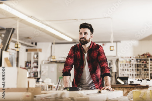 Portrait of confident man in workshop