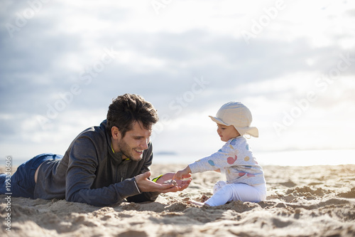 Spain, Lanzarote, father playing with baby girl on the beach