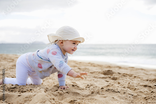 Spain, Lanzarote, baby girl crawling on the beach