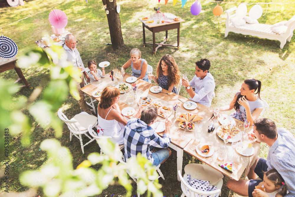 Fototapety, obrazy: Family celebration or a garden party outside in the backyard.