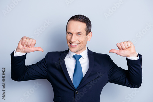 Photographie Cheerful financier, positive economist, confident politic man in formalwear with