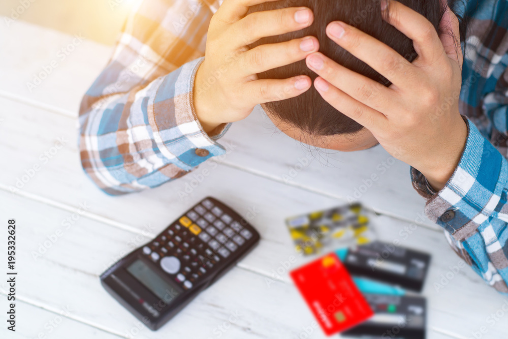 Fototapeta Concept of The woman is stressed with debt owed by using credit card