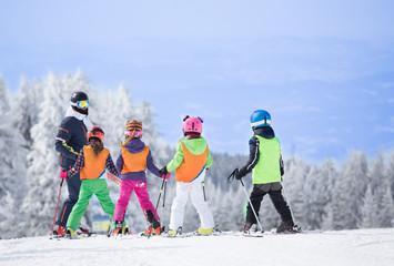 Ski school on mountain peak