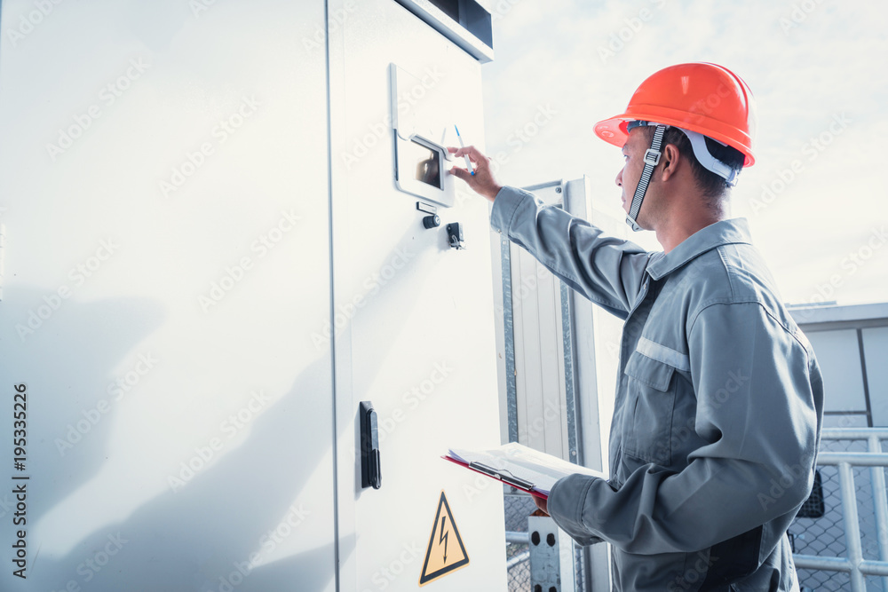 Fototapety, obrazy: solar power plant to innovation of green energy; engineer or electrician working on checking and maintenance equipment at solar power plant.