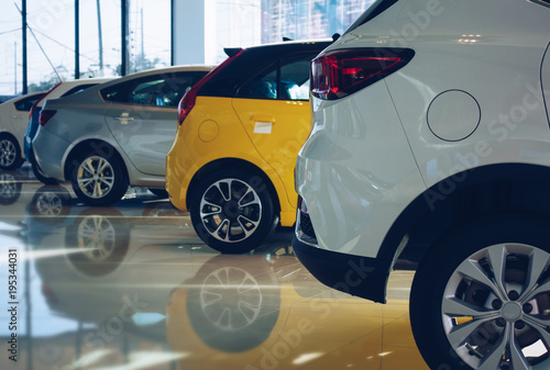 Fotografia, Obraz New cars at dealer showroom, Row new car in showroom, vintage filter