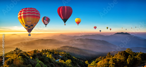 Valokuva Colorful hot air balloons flying over mountain at Dot Inthanon in Chiang Mai, Thailand