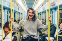 Waist Up Young Woman Travelling Underground Looking Camera Smiling - Traveller, Commuter, Happiness Concept