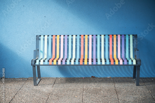 Fotografie, Obraz closeup of colorful metallic bench in the street