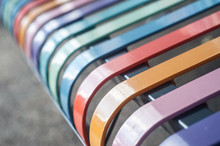 Closeup Of Colorful Metallic Bench In The Street