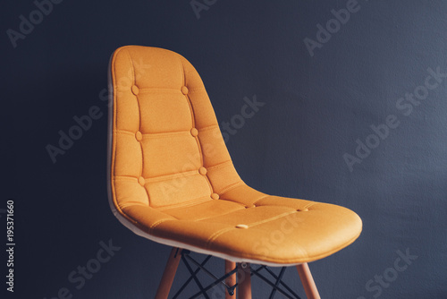 Empty generic yellow chair against waiting room gray wall - Buy this ... 3977921400e