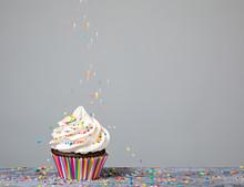 Decorating Cupcake With Sprink...